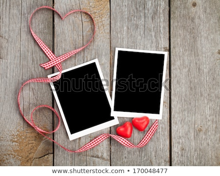 photo frame and small red candy hearts stock photo © karandaev