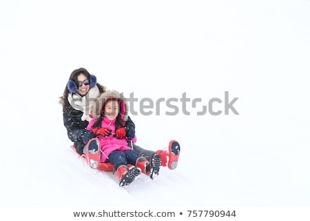 child sledding down the hill in snow, white winter Stock photo © meinzahn