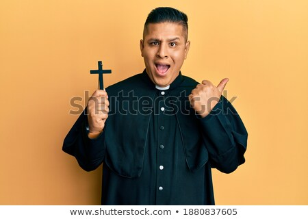 hands of a young latin men with a crucifix stock photo © alexandrenunes