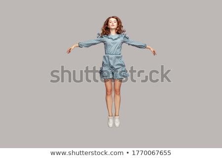 Levitatie elegante dame springen grijs meisje Stockfoto © Novic