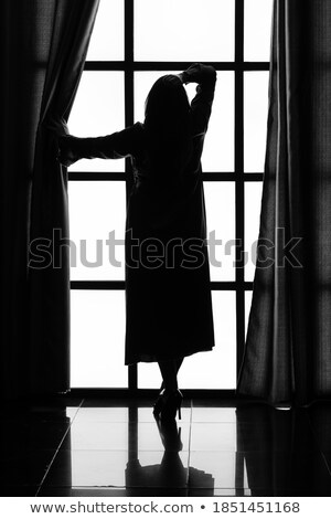 woman in black peignoir Stock photo © ssuaphoto