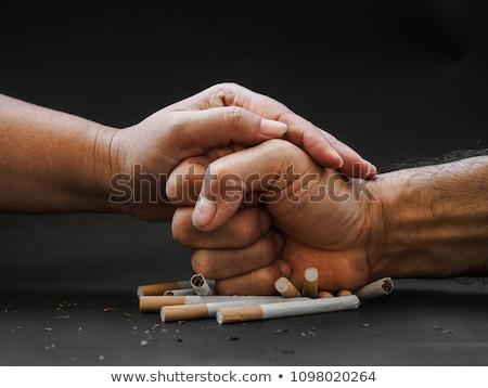 Punch in cigarettes Stock photo © fuzzbones0