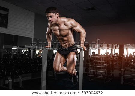 Hombre guapo ejercicio paralelo bares retrato fitness Foto stock © deandrobot