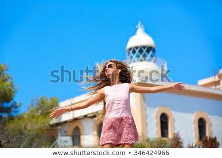 Sarışın kız açmak eller akdeniz deniz feneri Stok fotoğraf © lunamarina