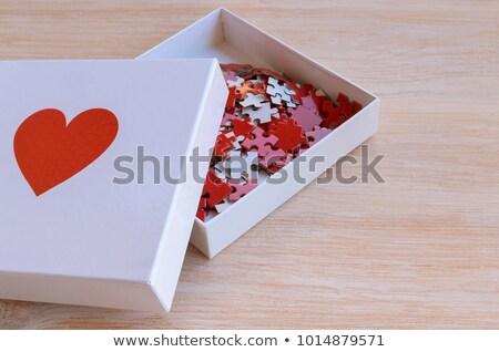 charity   white word on red puzzles stock photo © tashatuvango