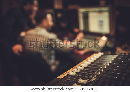 Stock photo: Electro guitar player and keyboarder working in studio