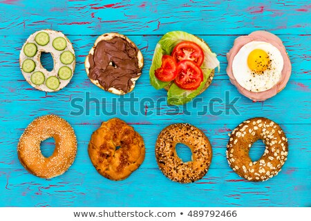Four fresh sliced bagels with assorted filling Stock photo © ozgur