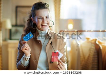 Nő tart végső vásár címke arc Stock fotó © stevanovicigor