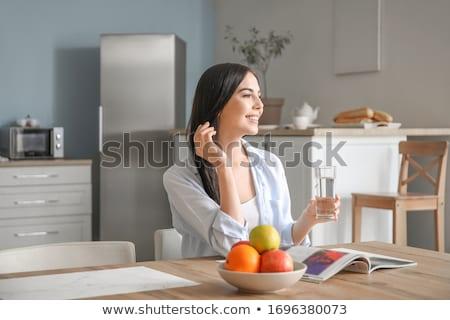 mulher · jovem · potável · vidro · isolado - foto stock © sapegina