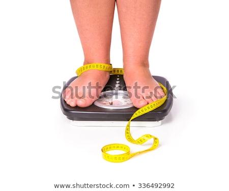 Zdrowych młoda kobieta masy fitness skali Zdjęcia stock © deandrobot