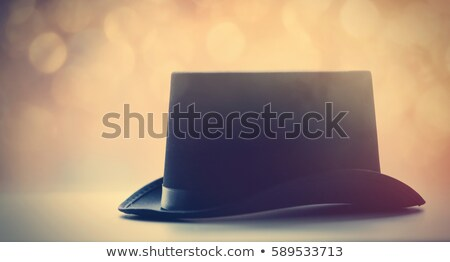 beautiful retro black hat on the fairy lights bokeh background Stock photo © Massonforstock