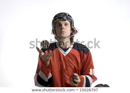 Hand Tossing Hockey Puck Stock photo © albund