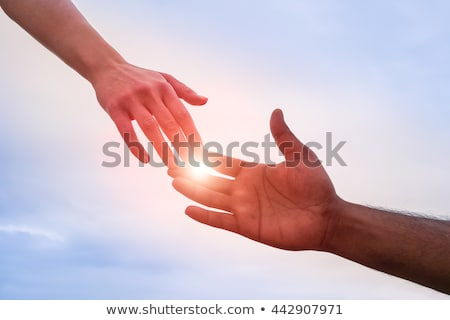 Business hands reach for handshake. Reach out Stock photo © MaryValery