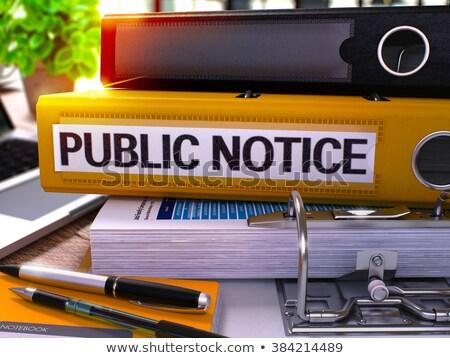 yellow office folder with inscription public notice stock photo © tashatuvango