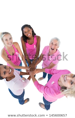 pink ribbon with breast cancer awareness women putting hands together stock photo © wavebreak_media
