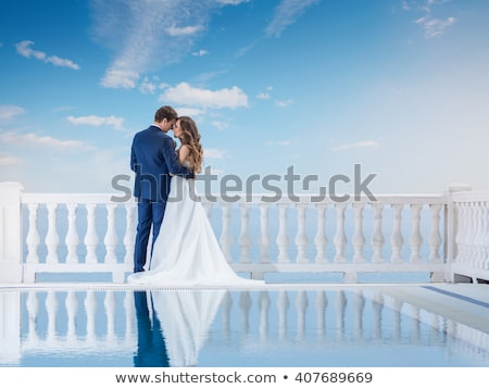 Bride and groom standing in pool Stock photo © IS2