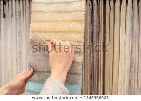 Woman choosing fabrics Stock photo © IS2