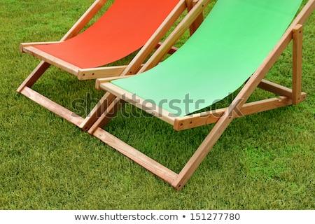 érett · pár · ül · fedélzet · székek · víz - stock fotó © is2