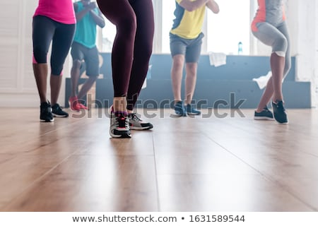 Partial view of young woman dancer in sportswear training on black  Stock photo © LightFieldStudios