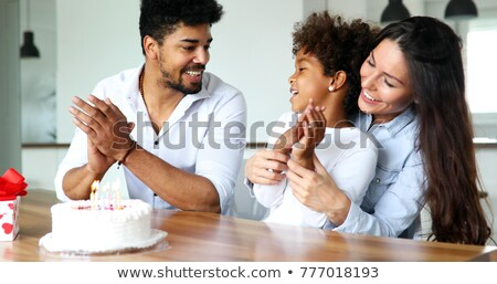 parents and child blowing out candles Stock photo © IS2