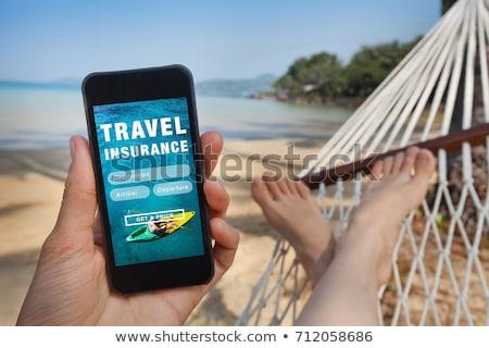 In tutto il mondo viaggio assicurazione online mobile Foto d'archivio © stevanovicigor