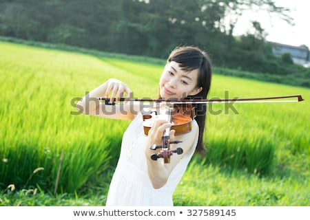 Smiling woman playing with grains Stock photo © IS2