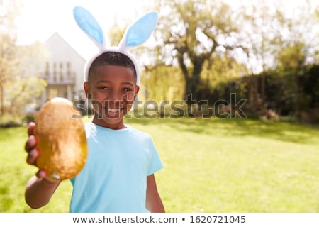 Child holding chocolate eggs Stock photo © IS2