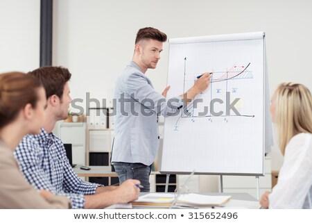 zakenman · bespreken · grafiek · collega's · kantoor - stockfoto © wavebreak_media