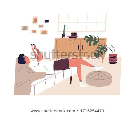 мальчика смартфон кровать домой детство связи Сток-фото © dolgachov