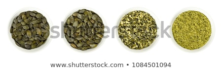 macro photo of organic pumpkin seeds healthy food top view stock photo © artjazz