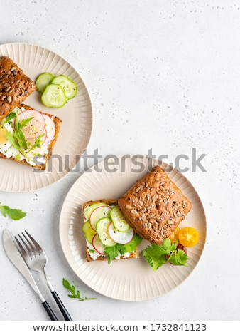 Homemade bread with fresh creame, herbs and radishes Stock photo © Peteer