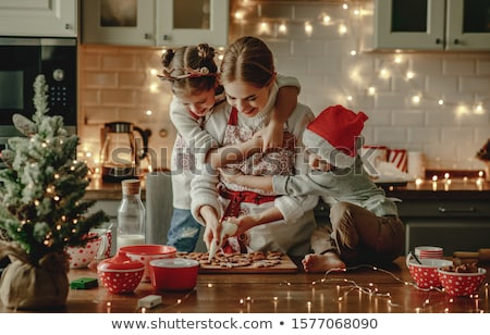 Family cooking Christmas cookies. Stock photo © choreograph