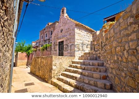 Eski taş dar sokak küçük kilise kasaba Stok fotoğraf © xbrchx