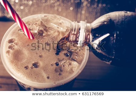 Glasses of energy carbonated soda drink with ice Stock photo © DenisMArt
