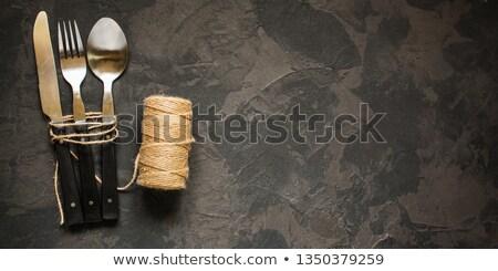 Rustic vintage set of cutlery knife, fork. Stock photo © artsvitlyna