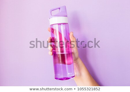 woman with smartphone, water and fitness tracker Stock photo © dolgachov