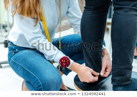 Alterations tailor measuring trousers on a customer Stock photo © Kzenon