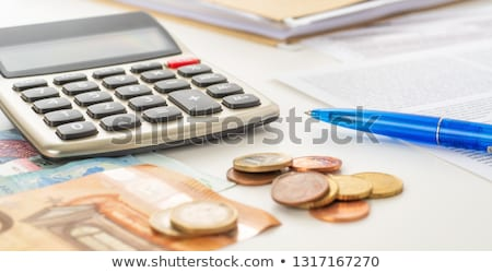 Calculator with euro bills and coin stacks Stock photo © Zerbor