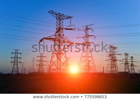 torres · alta · tensão · pôr · do · sol · nuvens · rede · indústria - foto stock © glasaigh