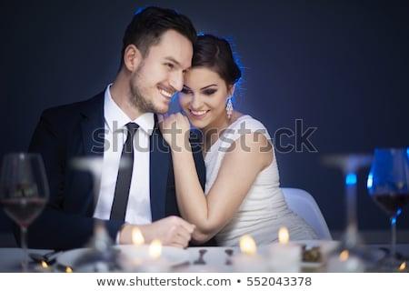 Kép boldog jóképű férfi hivatalos visel ül Stock fotó © deandrobot