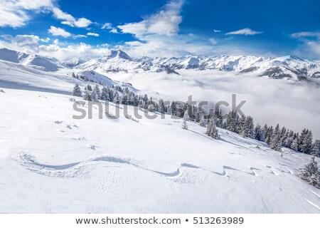 Szent hegyek fedett hó kilátás felhők Stock fotó © frimufilms