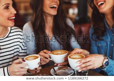 Amici coffee shop sorridere giovani laptop Foto d'archivio © Kzenon