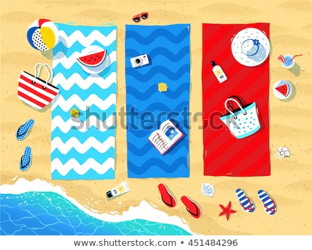 sunglasses and book on beach towel on sand Stock photo © dolgachov