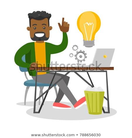 businessman sitting at workplace stock photo © jossdiim