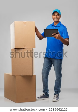 indian delivery man with tablet pc and parcel box Stock photo © dolgachov