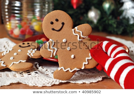hands in mittens holding gingerbread men stock photo © furmanphoto