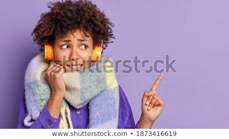 Young woman with frizzy hair wearing headphones Stock photo © Giulio_Fornasar