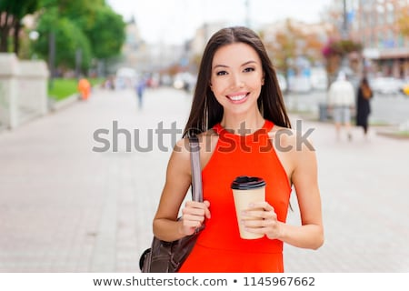 Image of young beautiful asian girl rejoicing and smiling at cam Stock photo © deandrobot