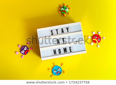 Clay characters on yellow background and board with Stay At Home Stock photo © dashapetrenko
