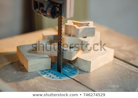 Woman sawing plank with band-saw Stock photo © photography33